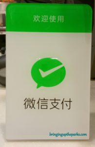 A local restaurant shows its customers that they accept WeChat payments