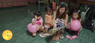 Shobe accidentally dropping in during a playdate and ending up reading the kids a book